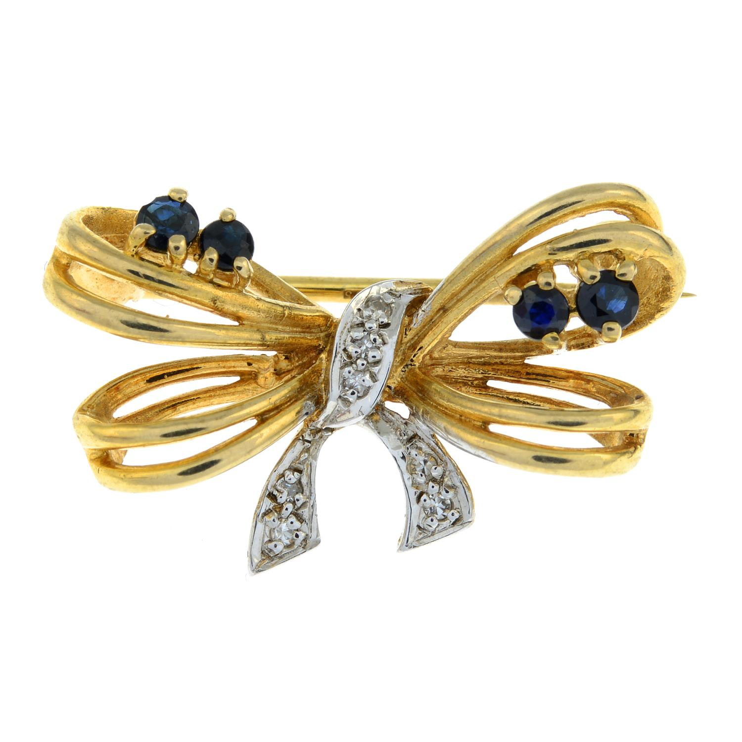 A 9ct gold sapphire and diamond brooch of a bow.Hallmarks for London.Length 2.6cms.