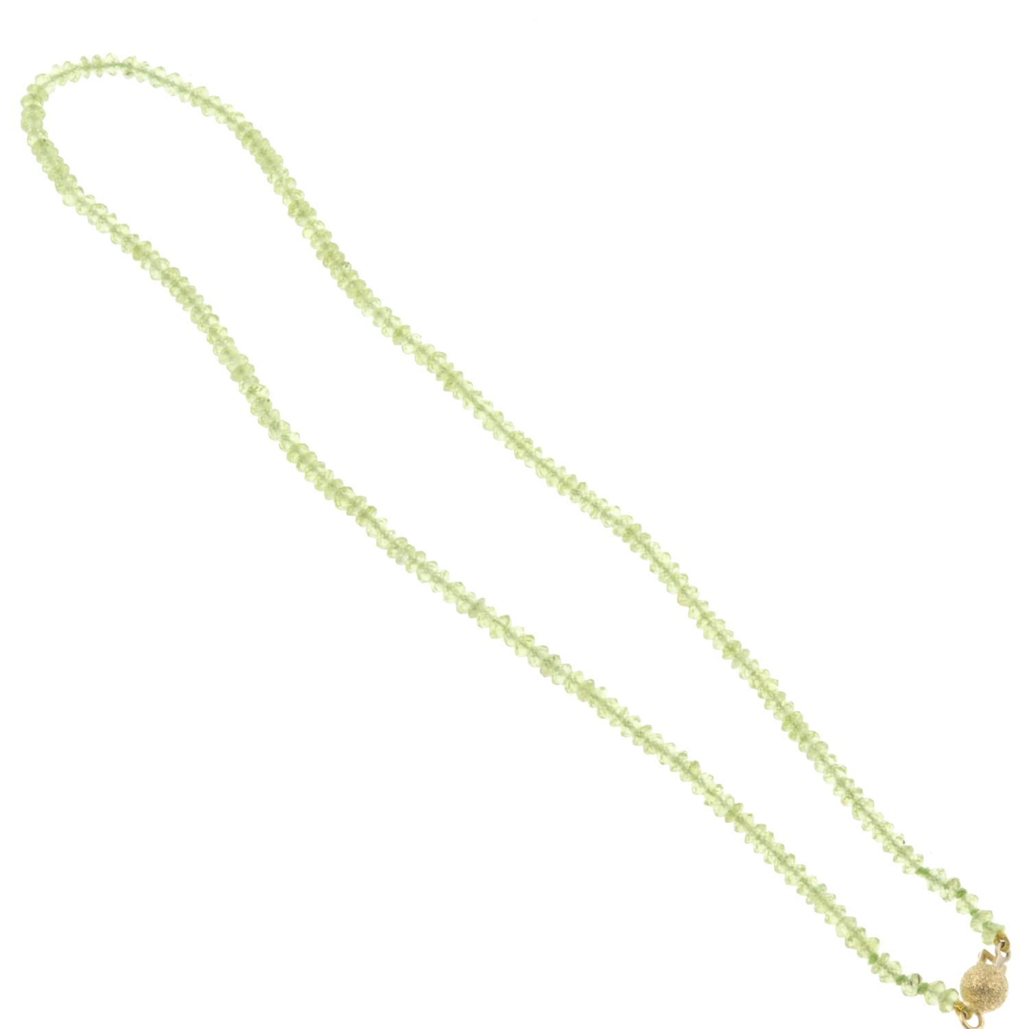 A peridot faceted bead necklace.Clasp stamped 750.Length 39cms. - Image 2 of 2