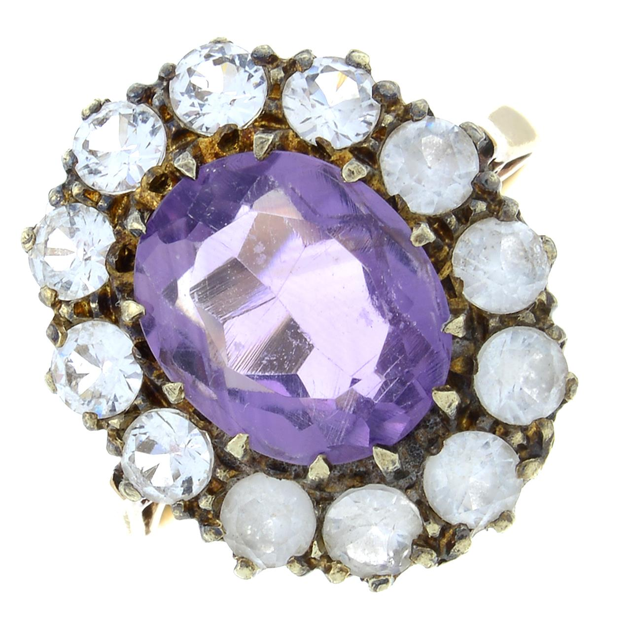 A 9ct gold amethyst and paste cluster ring.Hallmarks for Birmingham, 1973.Ring size P.
