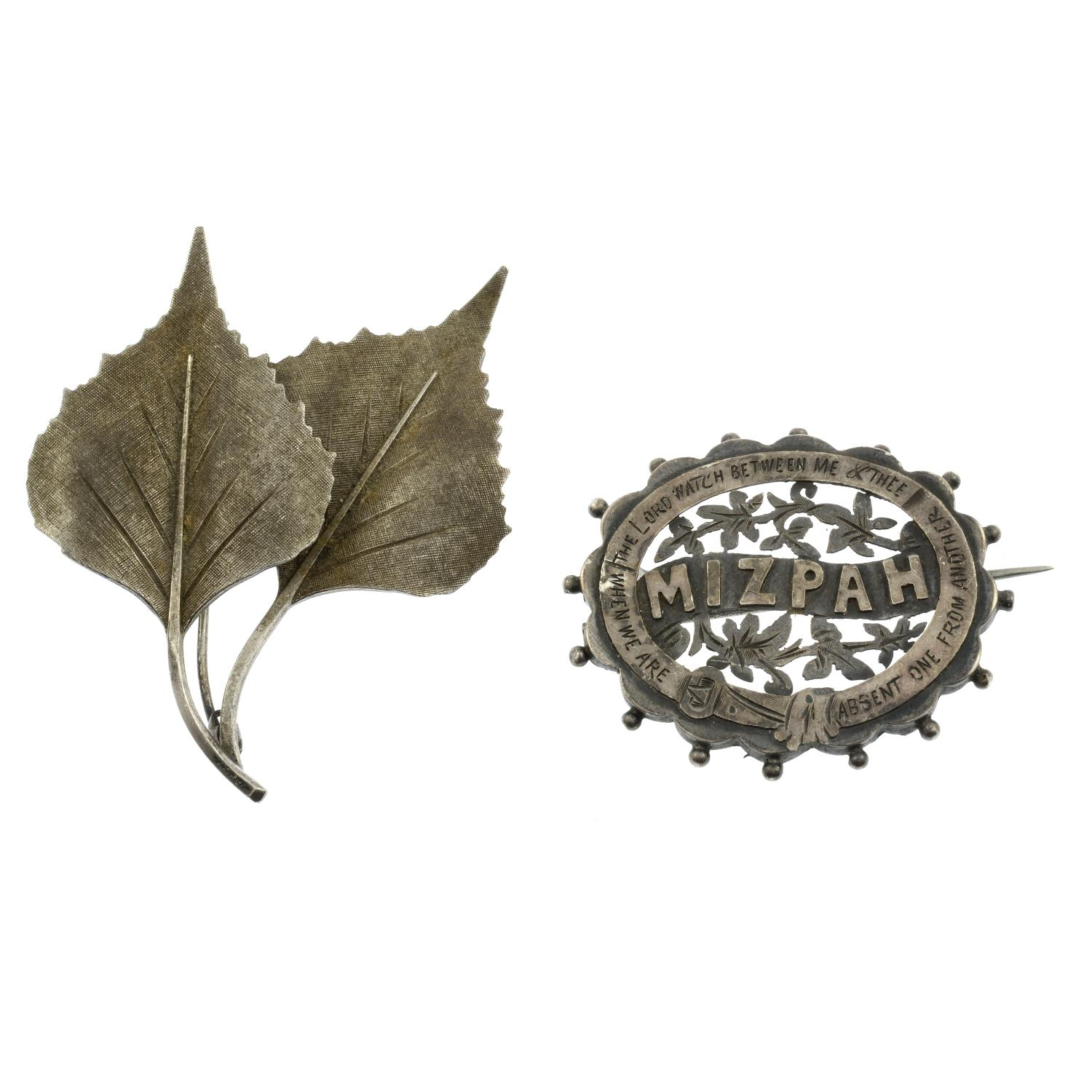 A selection of costume jewellery, to include two silver brooches.