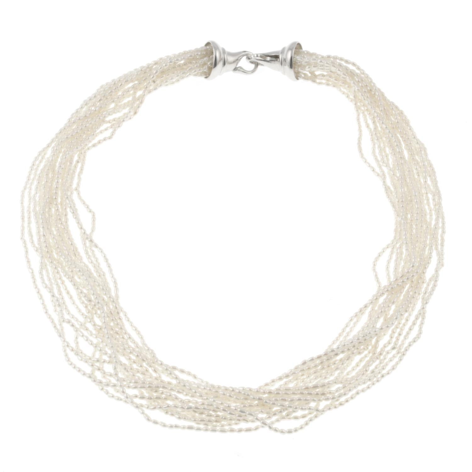 A multi-strand cultured seed pearl necklace.Clasp stamped 925. - Image 2 of 2