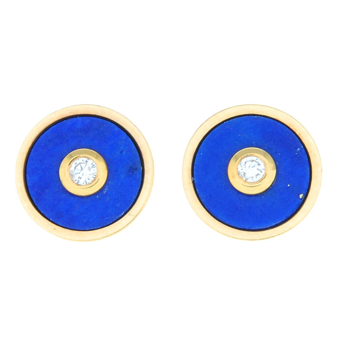 A pair of 18ct gold lapis lazuli and diamond stud earrings.Hallmarks for 18ct gold.Length 0.8cms.