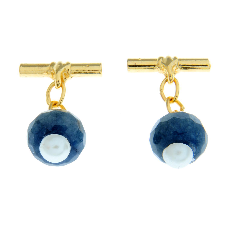 A pair of sapphire and imitation pearl cufflinks.Diameter of cufflink face 1.2cms.