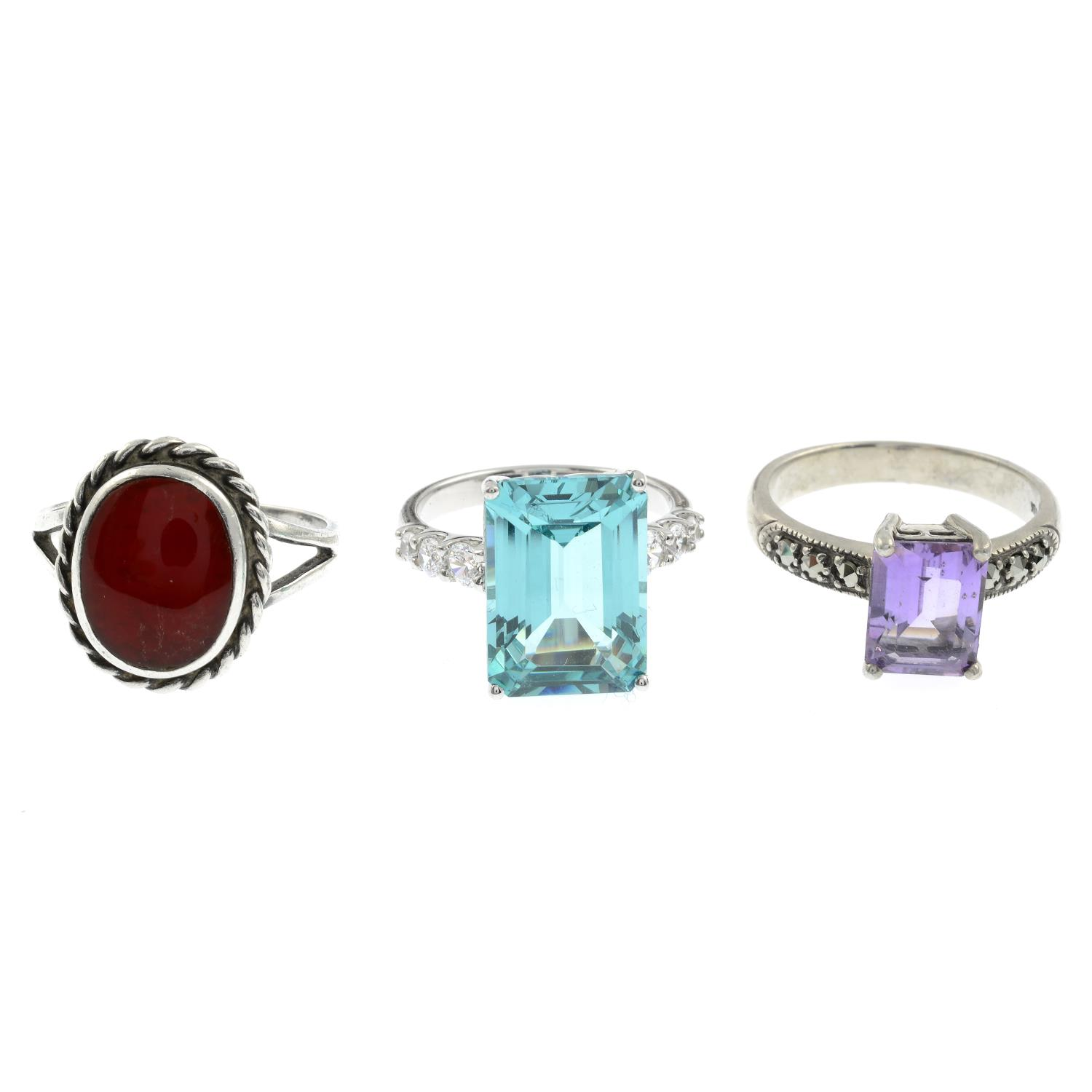A selection of mainly gem-set rings, to include a carved rose quartz ring.