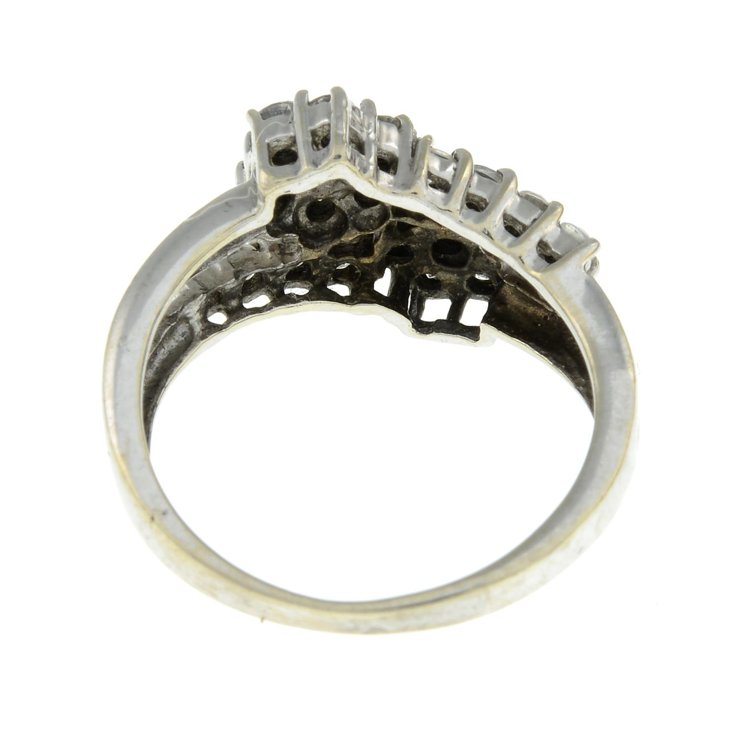 A 9ct gold cubic zirconia cluster crossover ring.Hallmarks for Birmingham.Ring size J. - Image 3 of 3