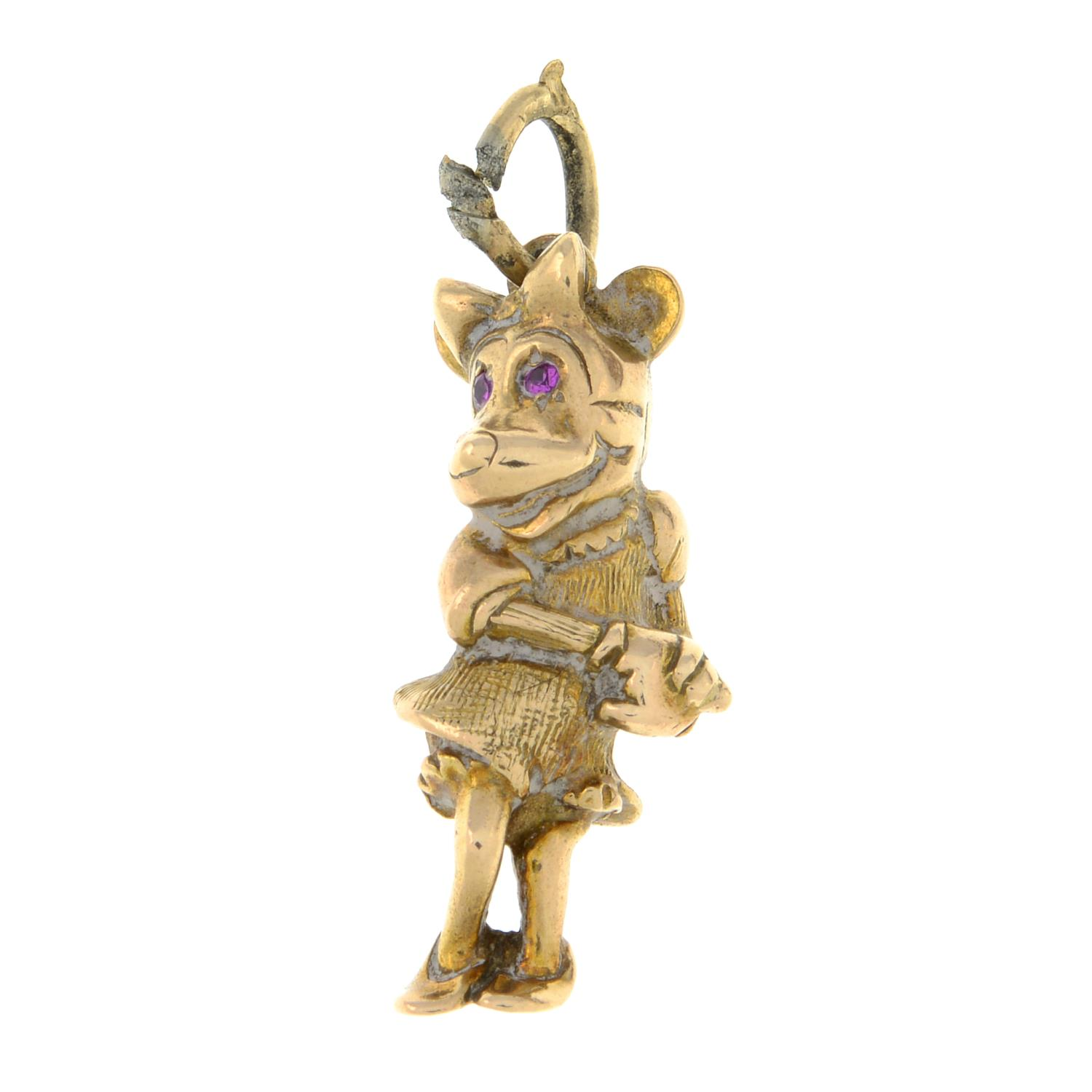 A 9ct gold 'Minnie Mouse' charm, with pink sapphire eye detail.Hallmarks for London.Length 2.9cms.
