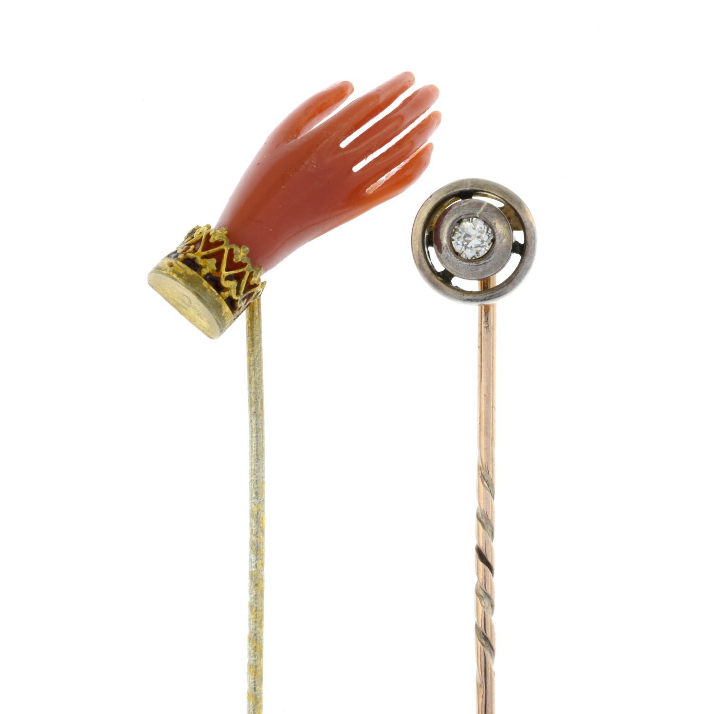 An old-cut diamond stickpin and a coral hand stickpin.Estimate diamond weight 0.1cts,
