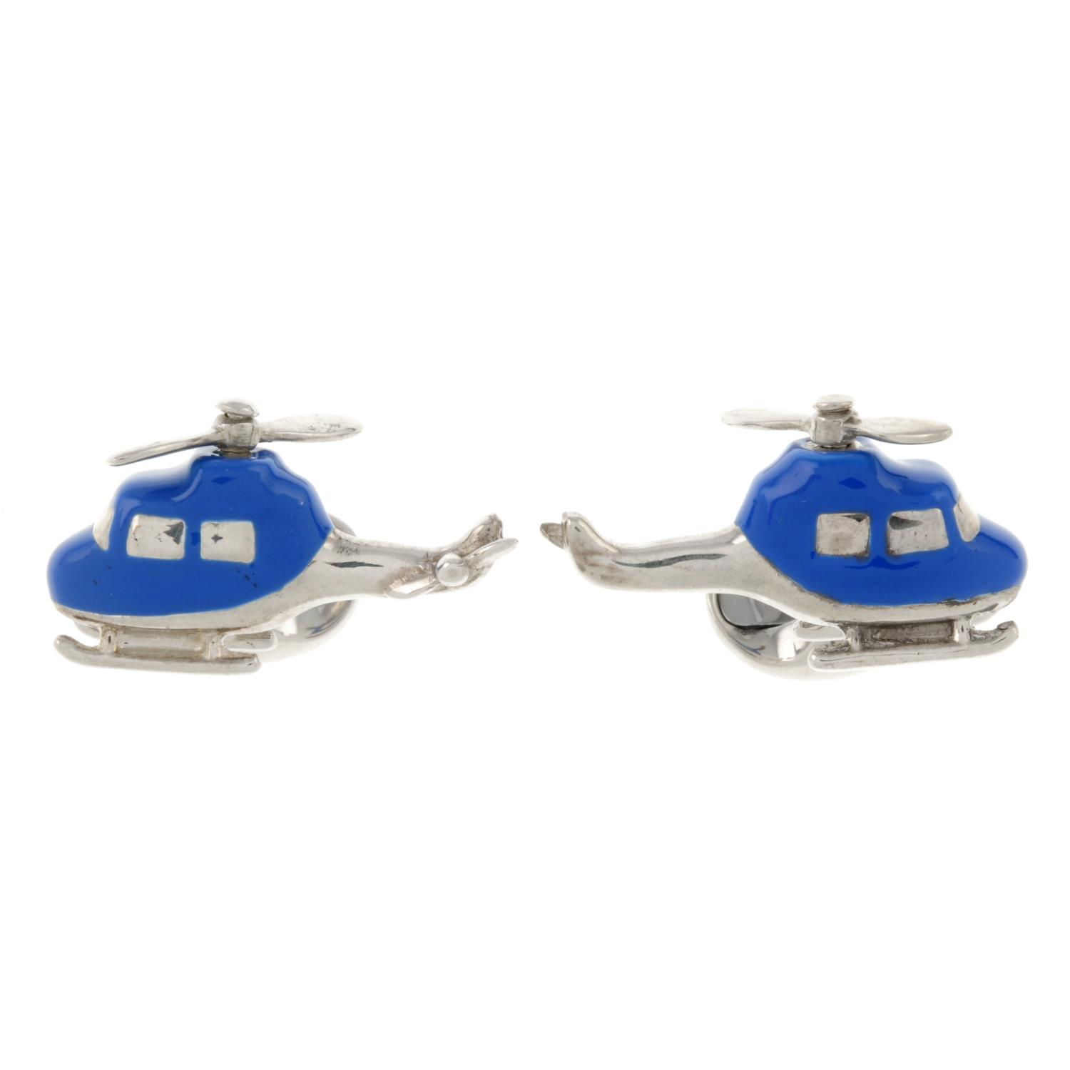 A pair of silver and blue enamel helicopter cufflinks with rotating propeller,
