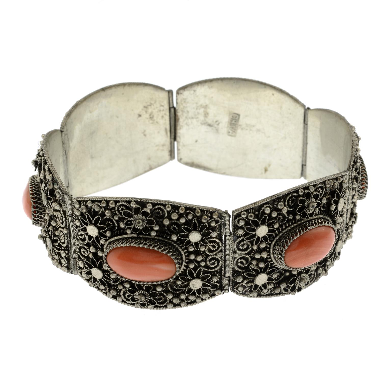 A selection of ceramic and marcasite costume jewellery, to include a coral bracelet.