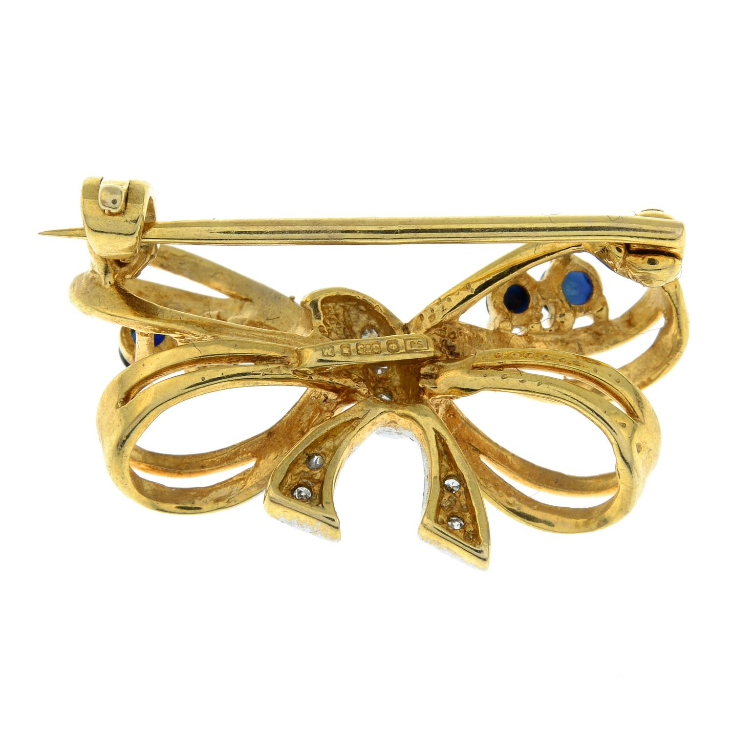 A 9ct gold sapphire and diamond brooch of a bow.Hallmarks for London.Length 2.6cms. - Image 2 of 2