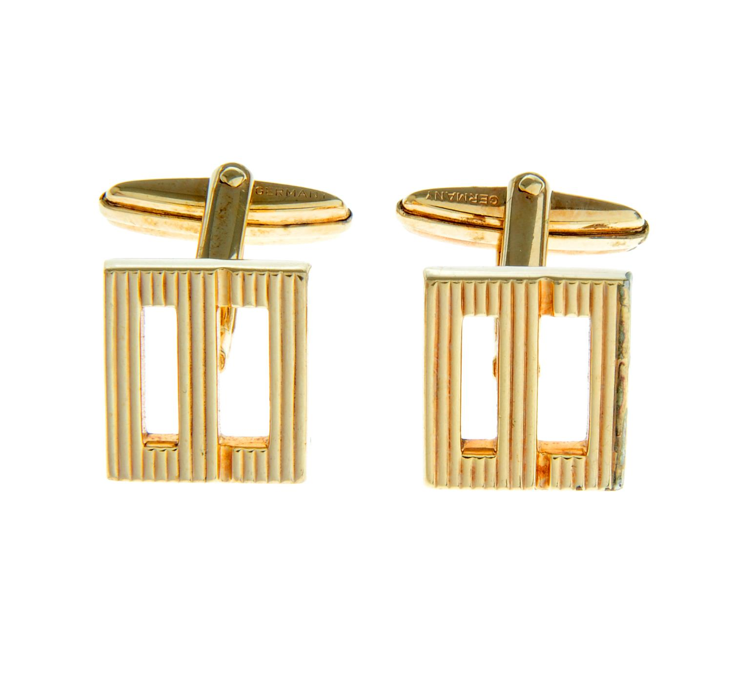 A pair of textured monogram cufflinks, by Christian Dior.Signed Chr.