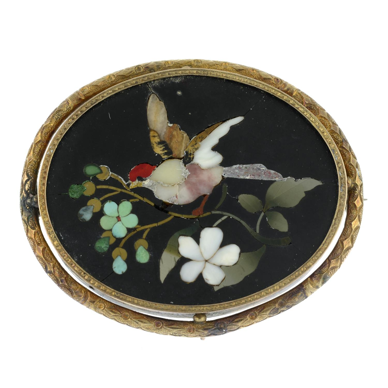A pietra dura brooch featuring a bird on a blossom branch.Length 5cms.