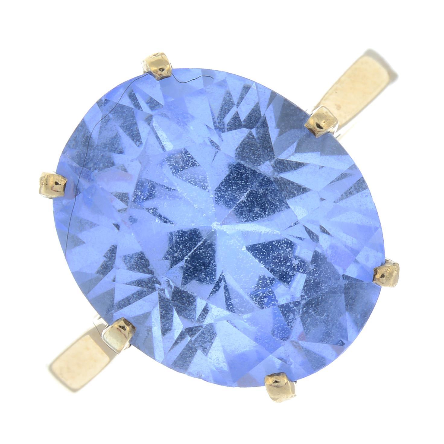 A topaz single-stone ring.Stamped 14K.
