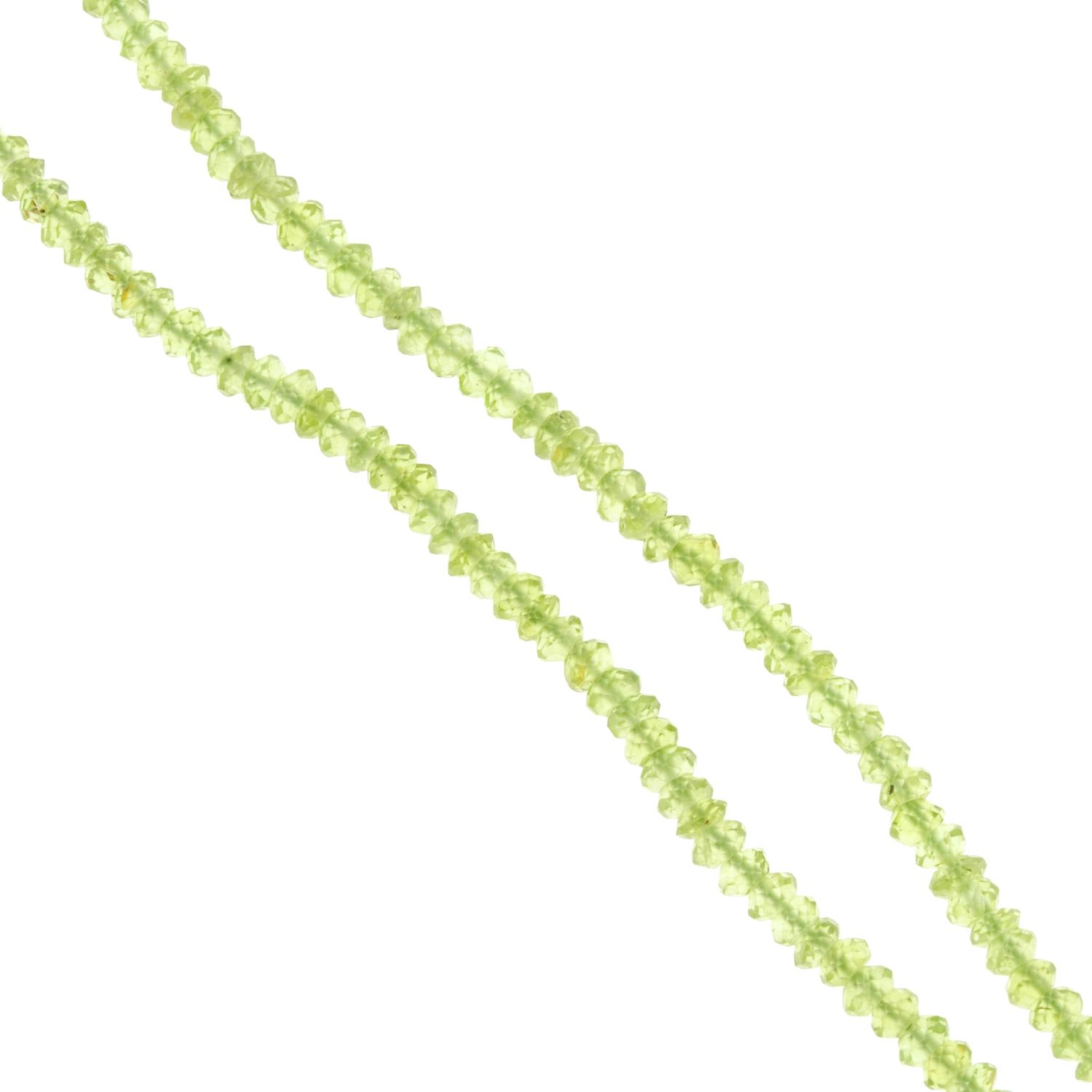 A peridot faceted bead necklace.Clasp stamped 750.Length 39cms.