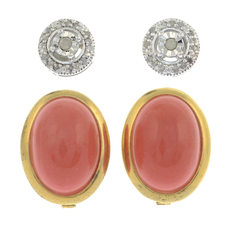 A pair of diamond stud earrings,