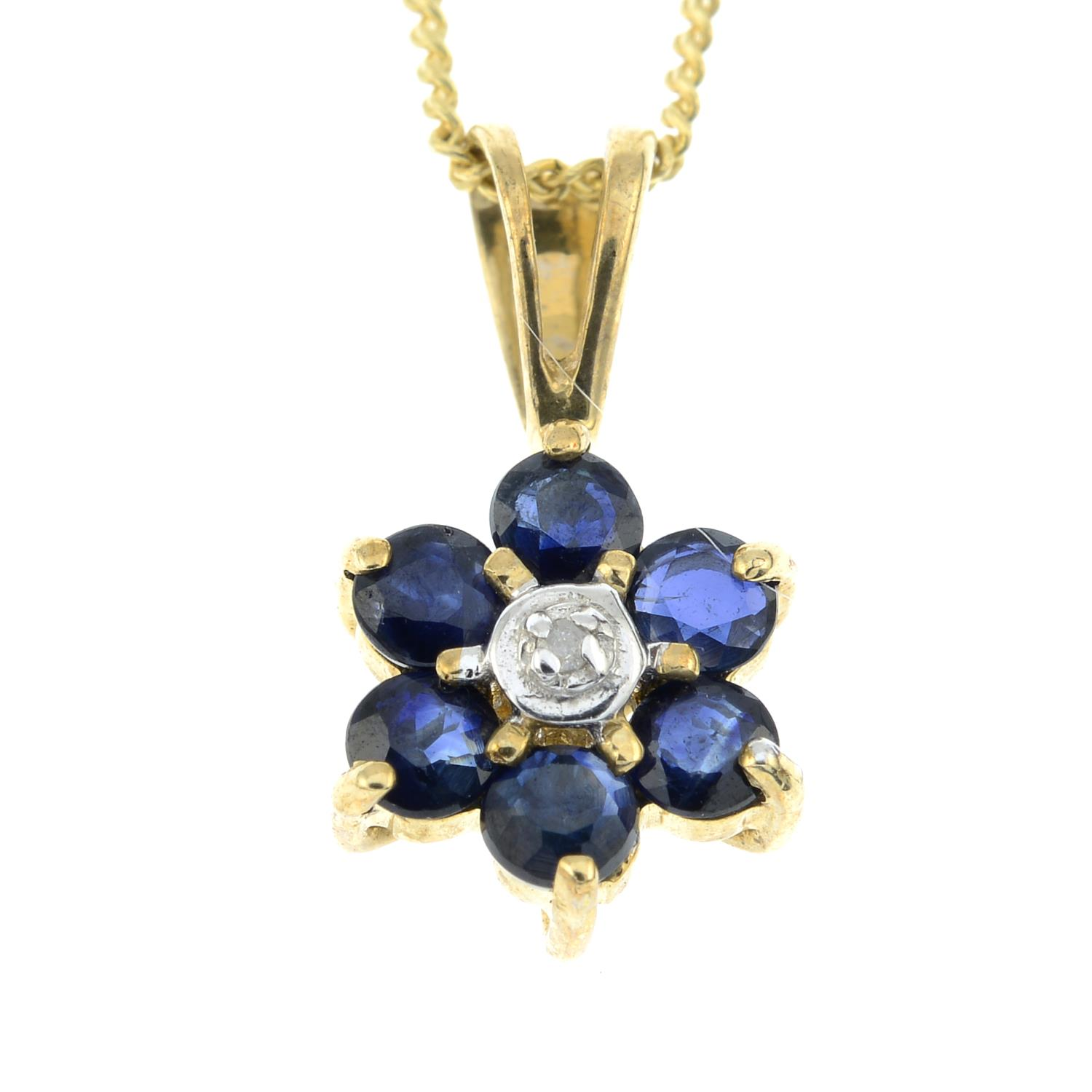 A sapphire and diamond pendant with chain along with a pair of garnet and diamond stud earrings.All