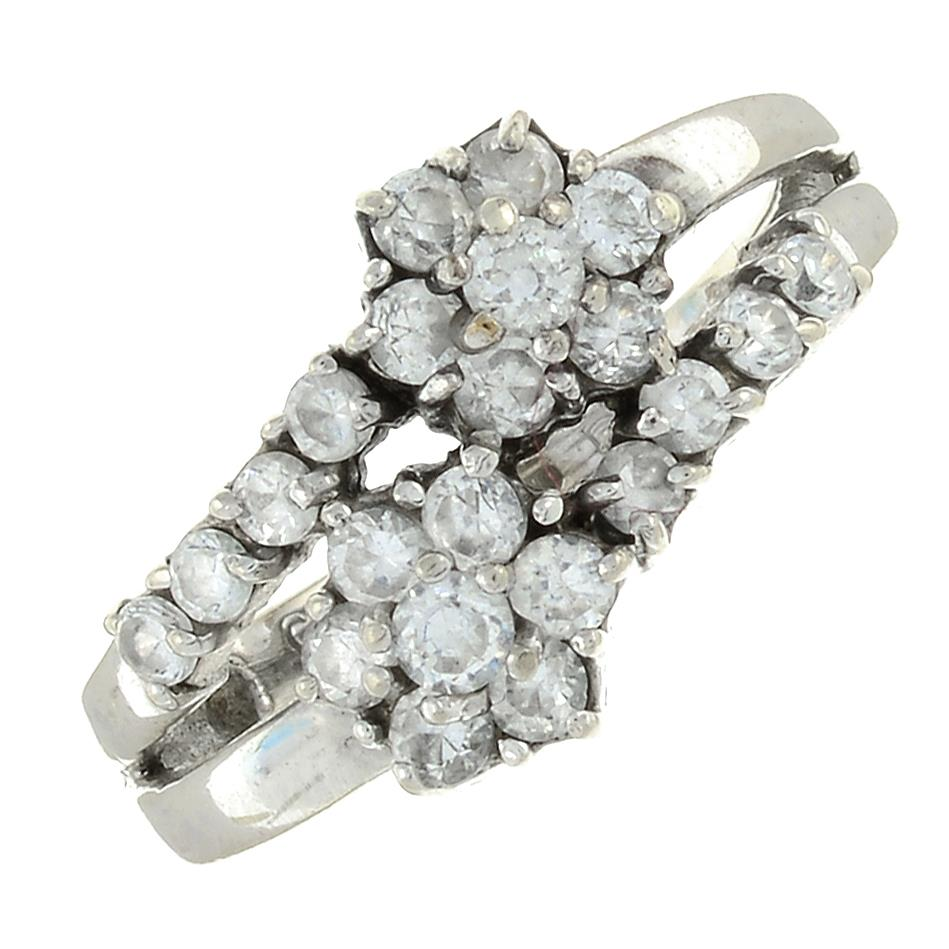 A 9ct gold cubic zirconia cluster crossover ring.Hallmarks for Birmingham.Ring size J.