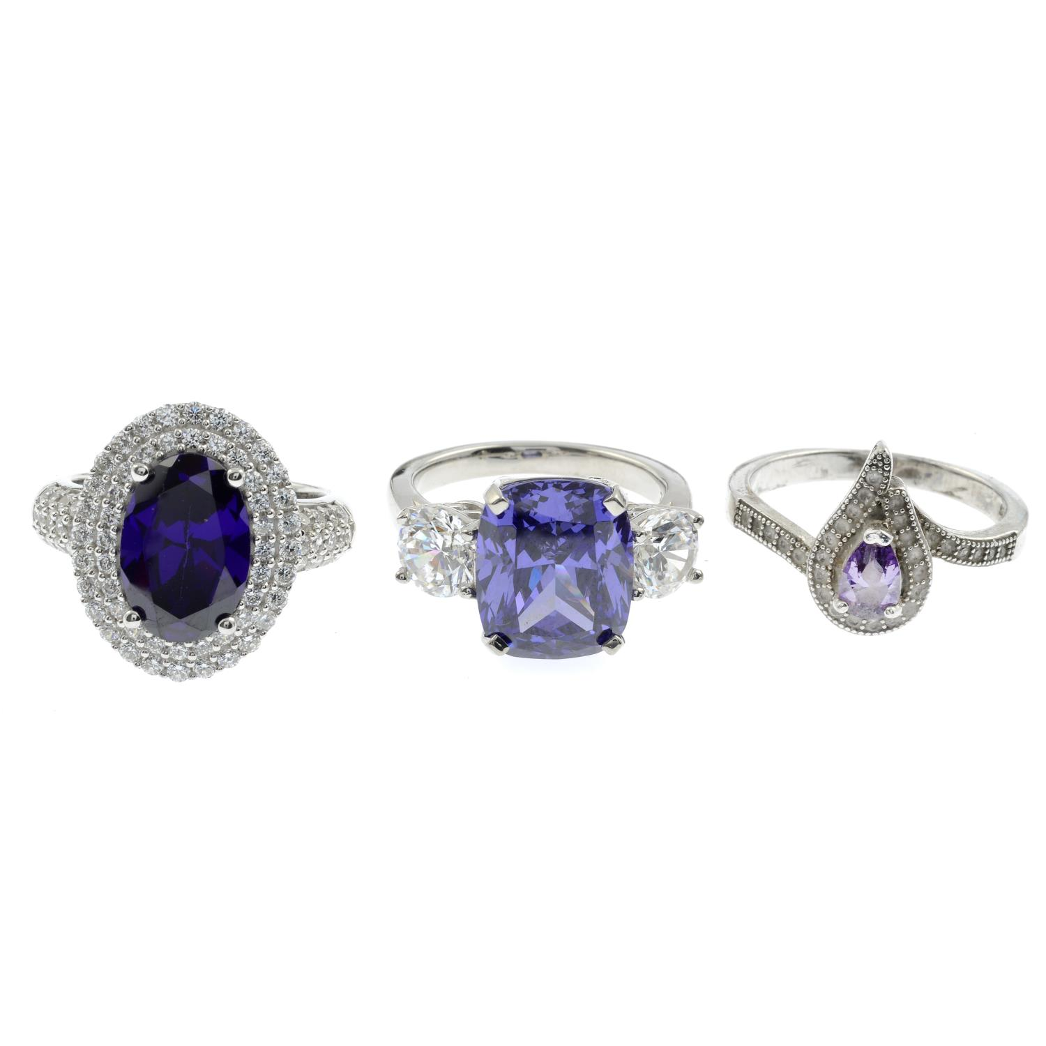 A selection of mainly gem-set rings, to include a three stone cubic zirconia ring.