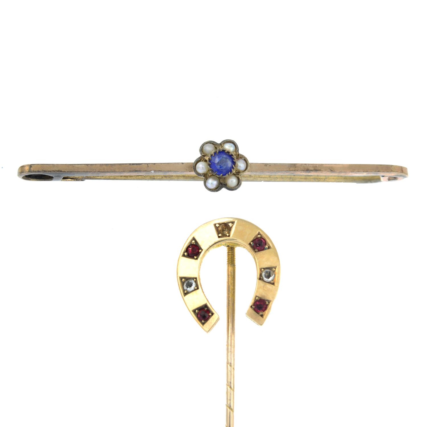 A 9ct gold paste horseshoe stickpin along with a paste a seed pearl bar brooch.