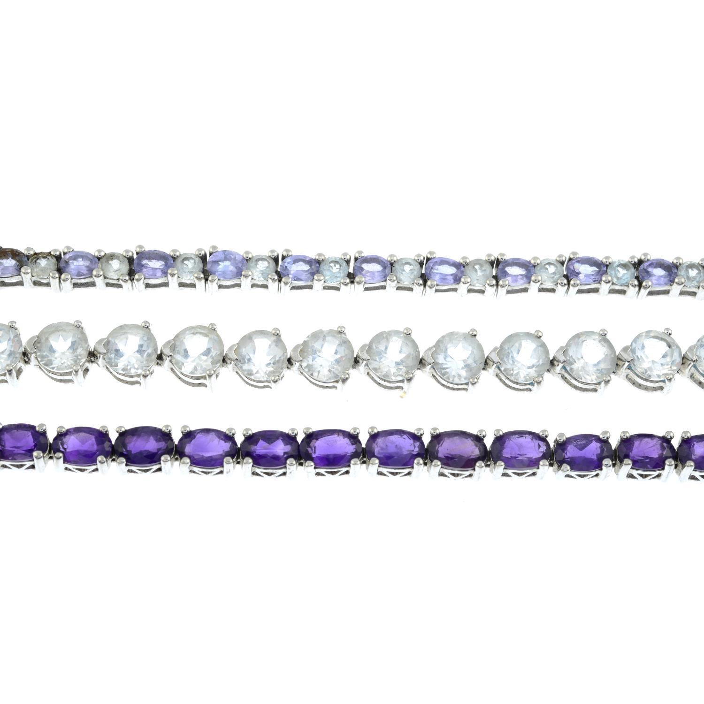 Three silver gem-set silver line bracelets,