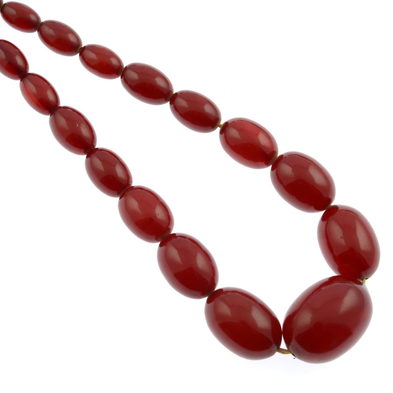 Four bakelite bead necklaces,