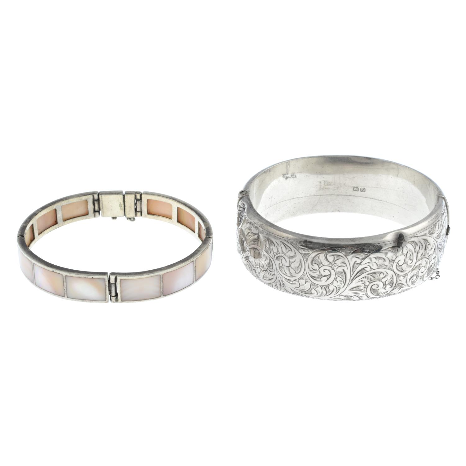 A selection of bangles, to include a silver pink mother-of-pearl bangle.