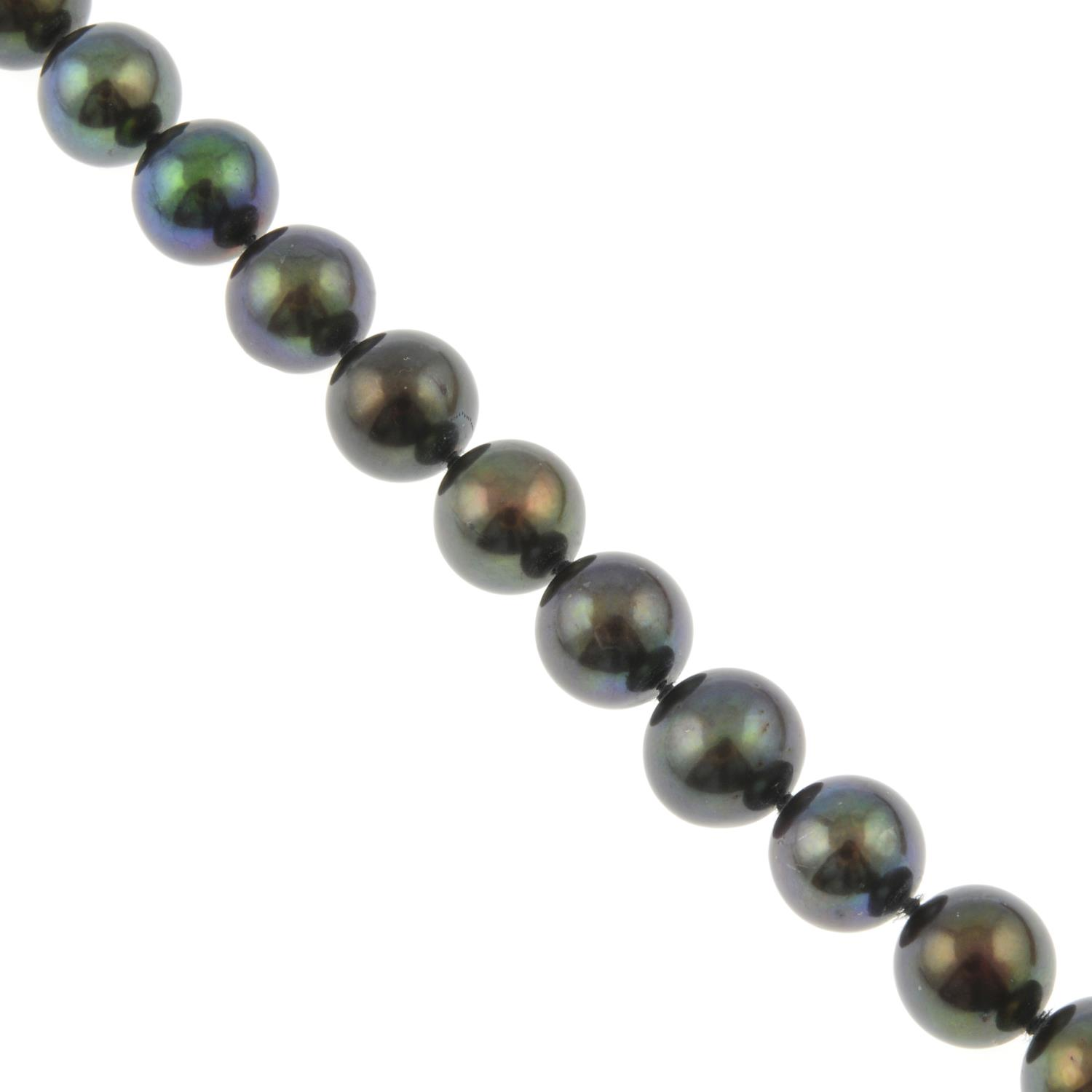 A black cultured freshwater pearl necklace.Clasp stamped 750.
