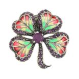 A ruby and plique-a-jour enamel brooch of a four-leaf clover.May be worn as a pendant.Stamped 925.