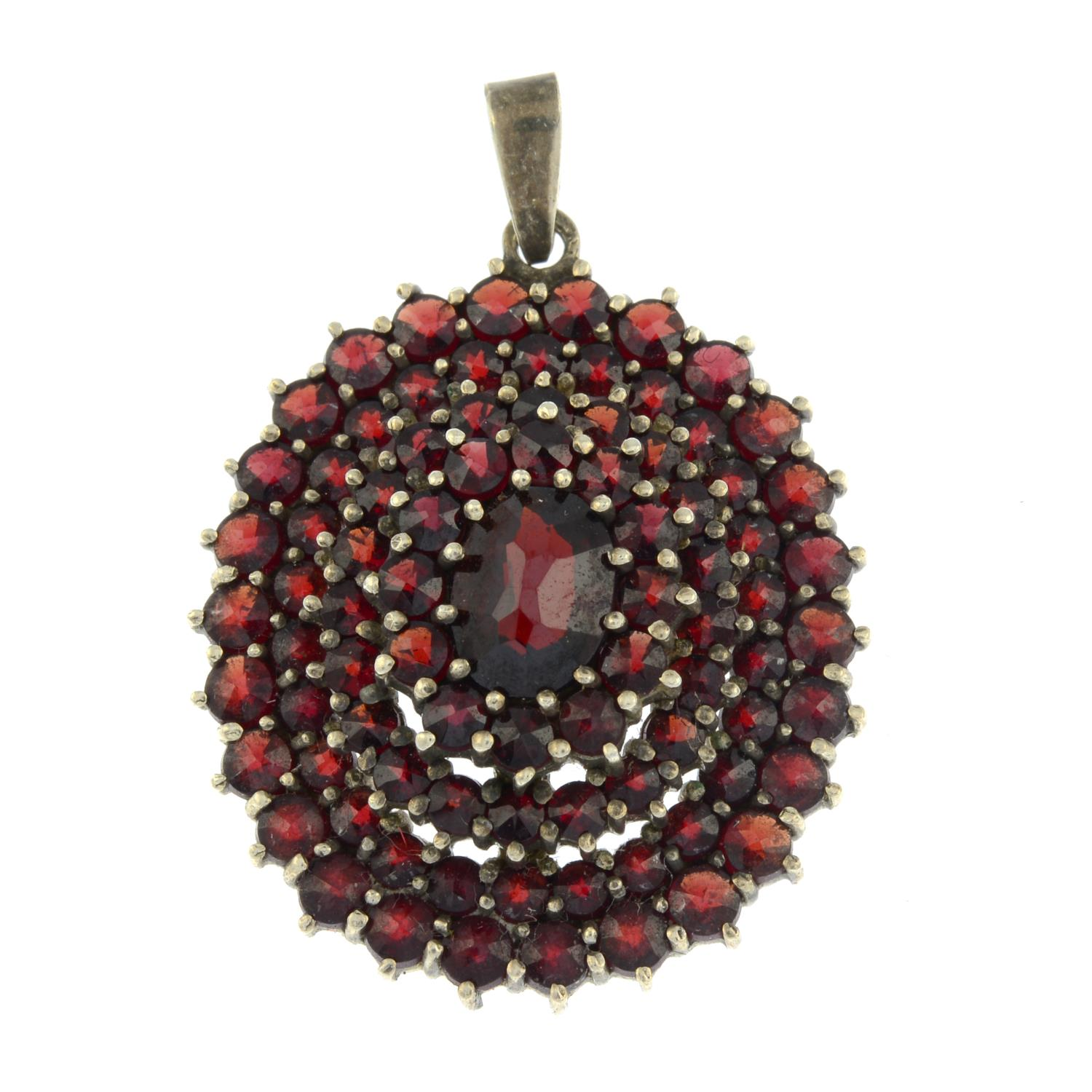 An early 20th century bohemian garnet pendant.Stamped 835.Length 3.7cms.