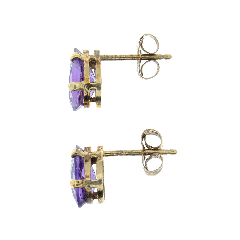 A pair of amethyst stud earrings and two pairs of hoops.Stud earrings stamped 10K. - Image 3 of 3