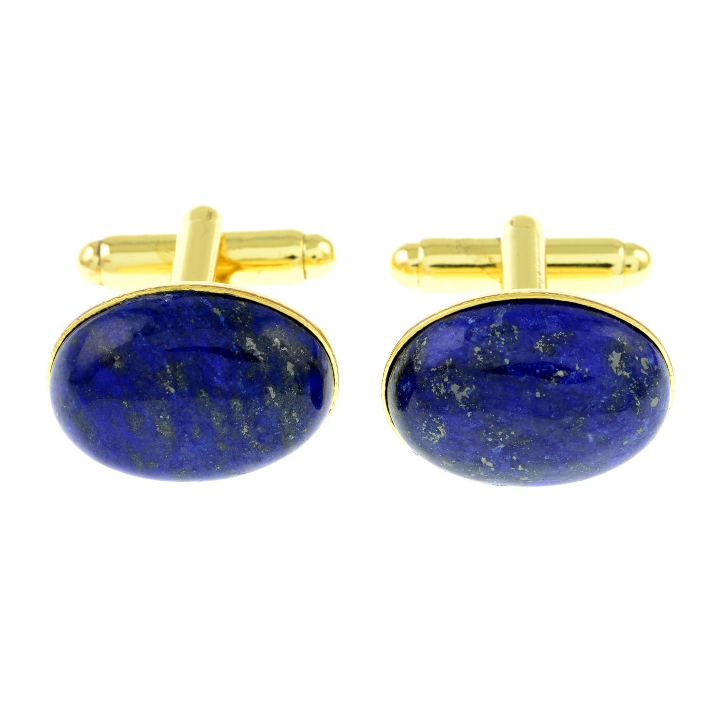 A pair of oval lapis lazuli cufflinks.Length of cufflink face 1.9cms.