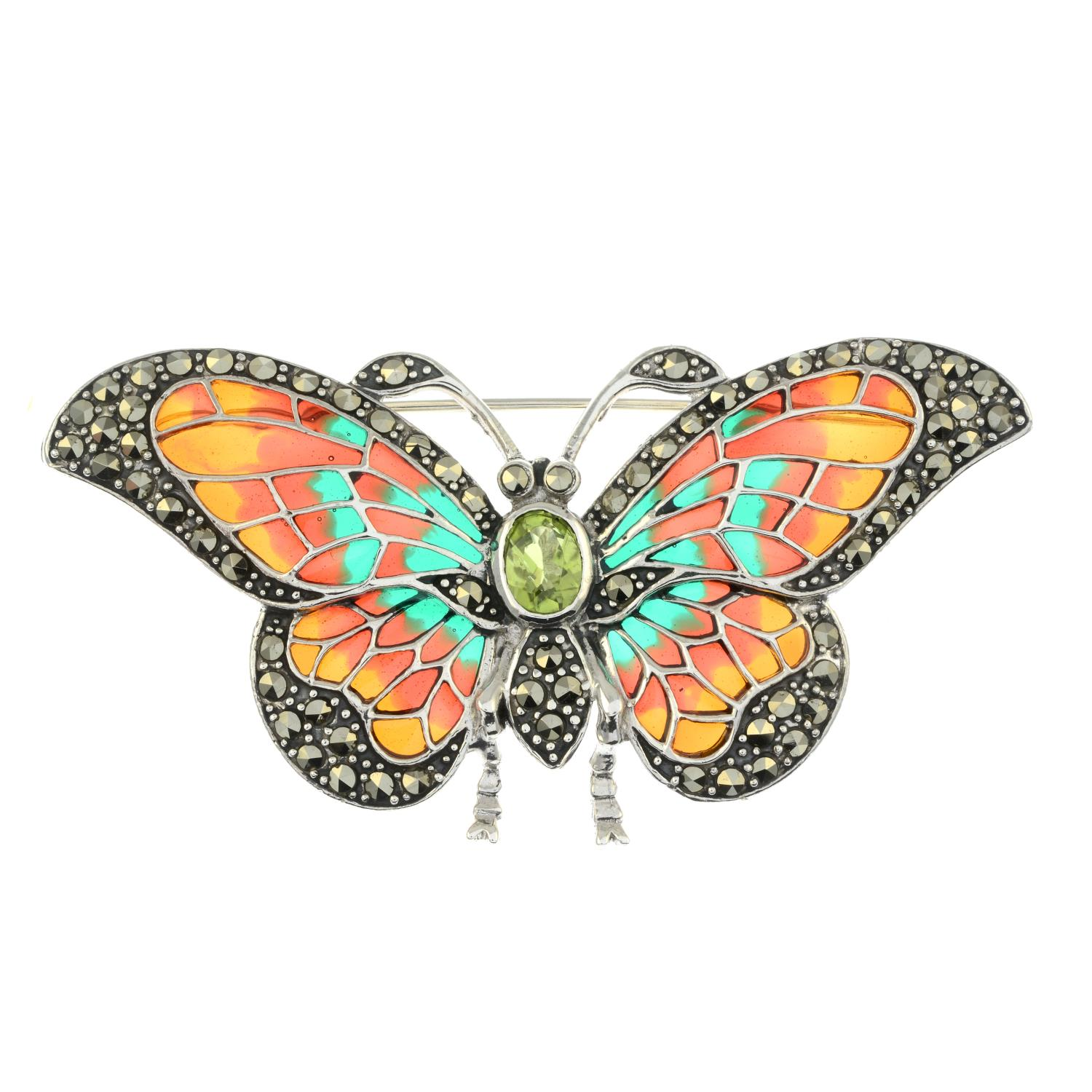 A peridot, pyrite and plique-a-jour enamel brooch of a butterfly.May be worn as a pendant.