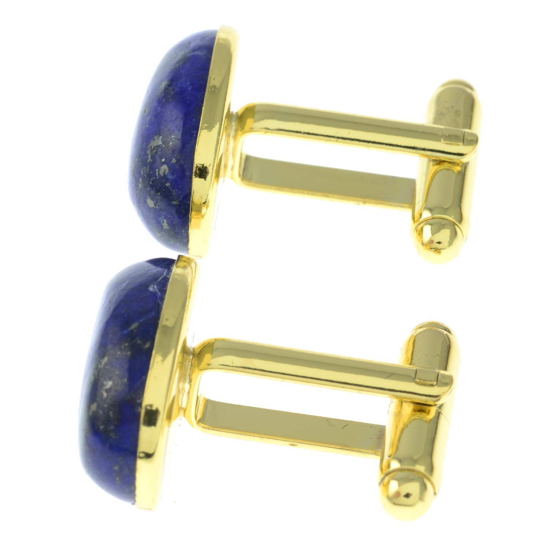 A pair of oval lapis lazuli cufflinks.Length of cufflink face 1.9cms. - Image 2 of 2