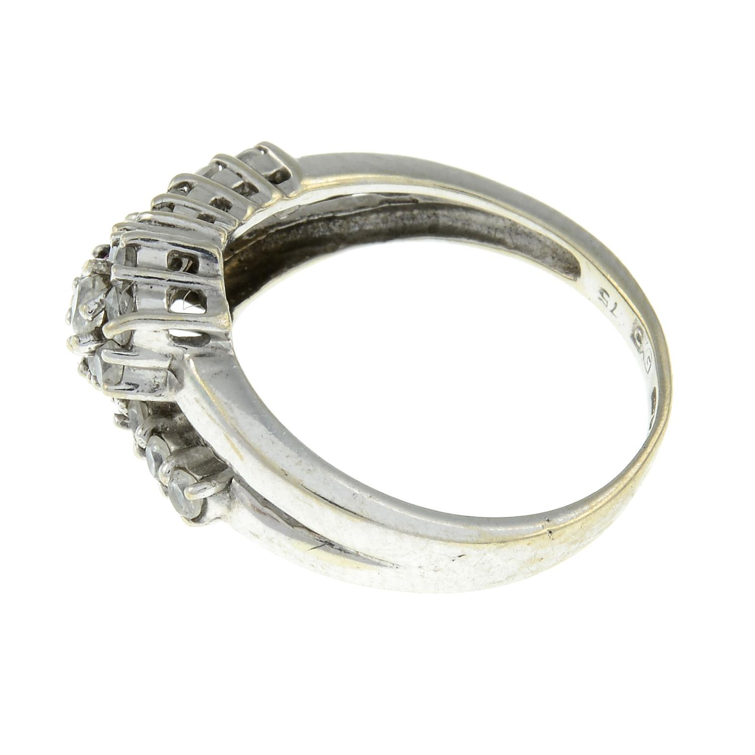 A 9ct gold cubic zirconia cluster crossover ring.Hallmarks for Birmingham.Ring size J. - Image 2 of 3