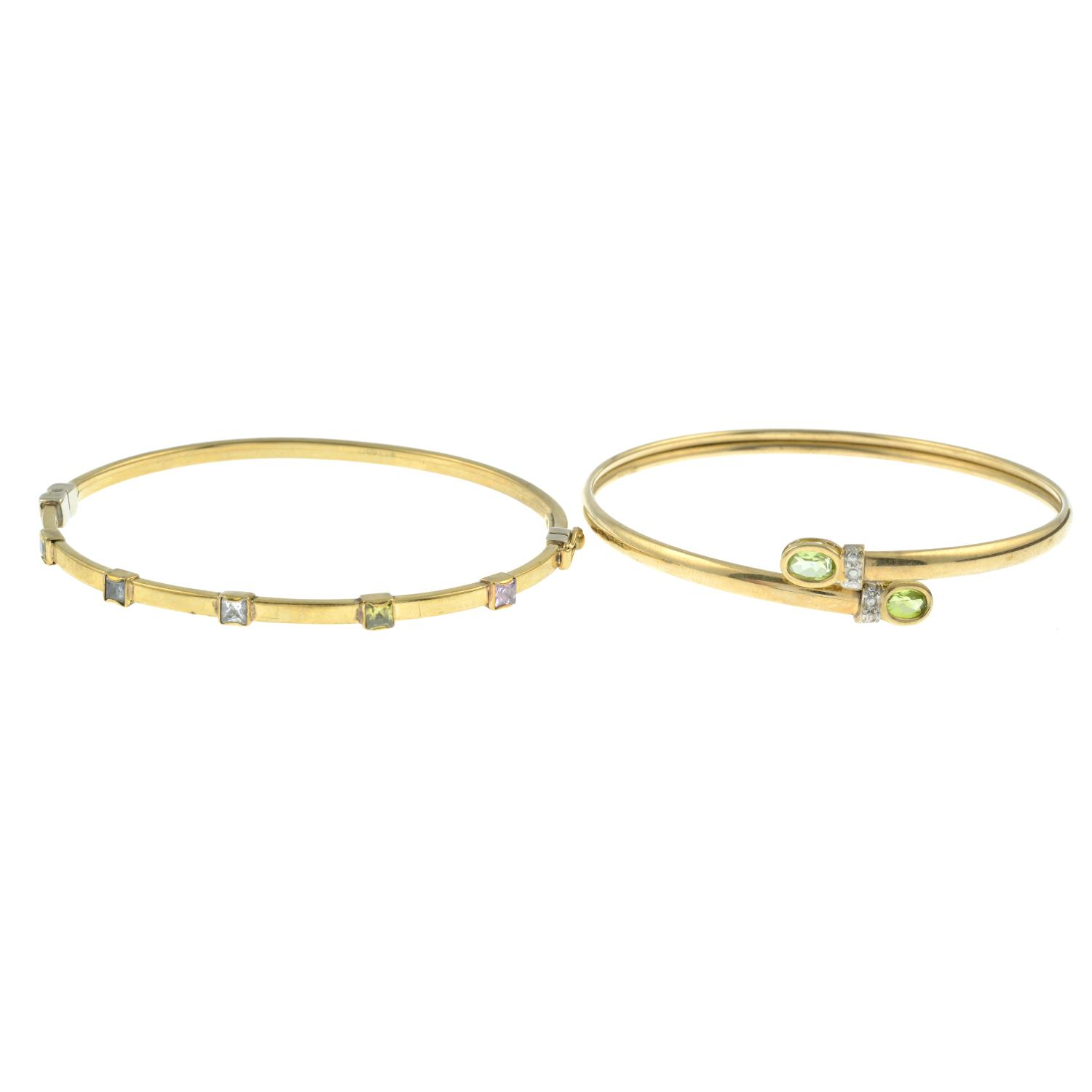 A 9ct gold multi-gem bangle along with a 9ct gold peridot bangle.Both stamped 375.