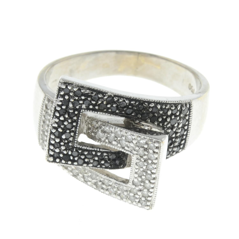 An 18ct gold diamond dress ring.Estimated total diamond weight 0.15cts.Hallmarks indistinct,