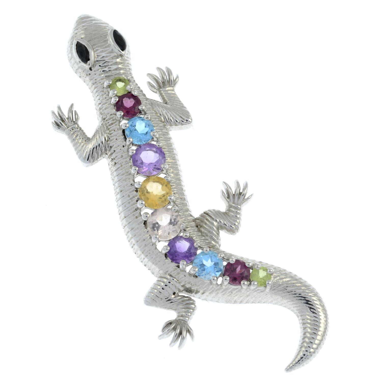 A gem-set silver pendant of a lizard.Stamped 925.Length 6cms.