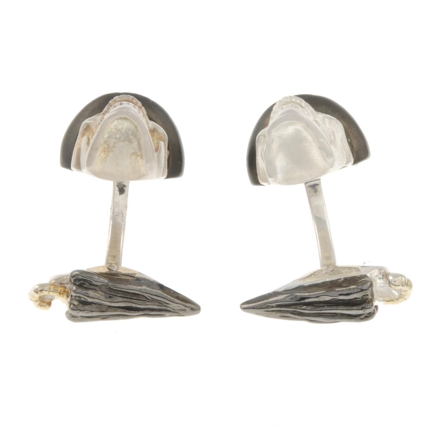 A pair of silver skull cufflinks, with articulated jaw and ruby eyes, by Deakin and Francis. - Image 3 of 3