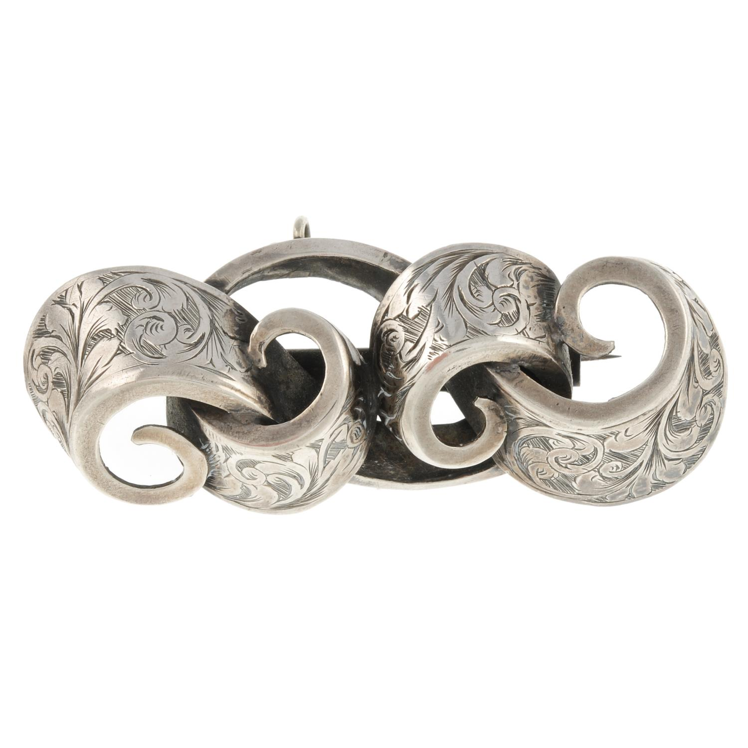 A Victorian engraved brooch, by Hilliard & Thompson.With maker's marks.Length 7cms.