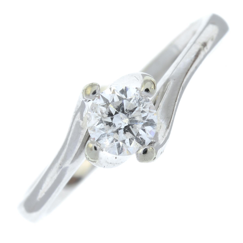 An 18ct gold diamond single-stone ring.Estimated diamond weight 0.33cts,