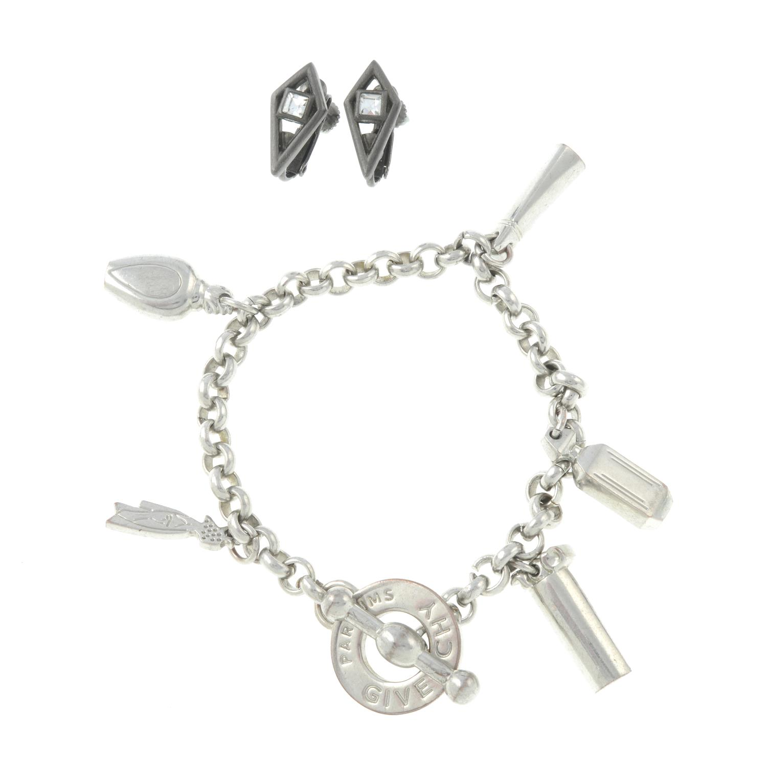 A pair of clip-on earrings and a charm bracelet,