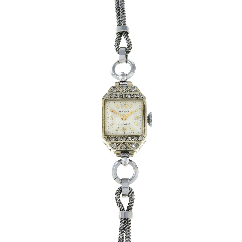 A Lady's diamond cocktail watch, by Hefik, Length 18cms.