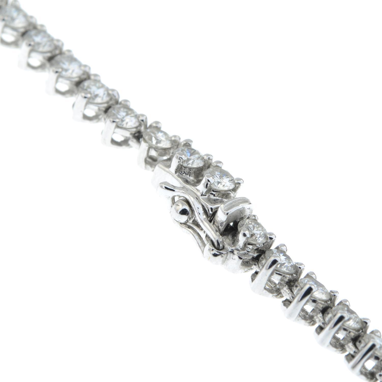 A graduated brilliant-cut diamond line necklace. - Image 6 of 6