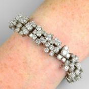 A brilliant-cut diamond abstract cluster line bracelet.