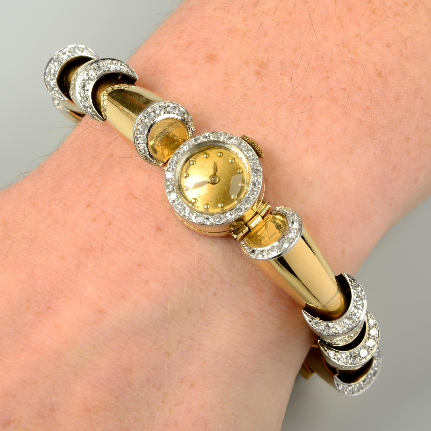 A 1940s gold diamond cocktail watch.Estimated total diamond weight 1.35cts,
