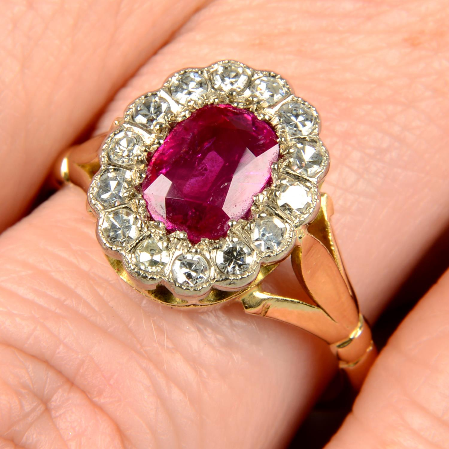 A Burmese ruby and diamond cluster ring.With report 81314-48,
