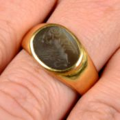 An agate intaglio signet ring, carved to depict Apollo riding in a chariot drawn by swans.