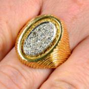 A 1970s 18ct gold pavé-set diamond signet ring, with fingerprint textured shoulders.