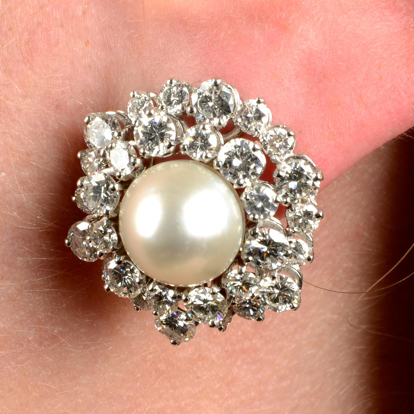 A pair of natural pearl and diamond cluster earrings.With report 77110-13,