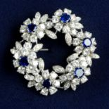 A mid 20th century 18ct gold sapphire and diamond floral wreath brooch.Estimated total sapphire